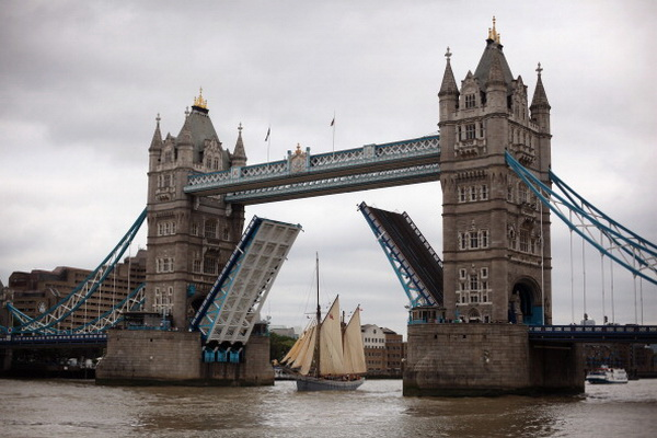 LONDON, ENGLAND - MAY 18: A 37 meter wooden sailing freighter sails under Tower Bridge after sailing from Bordeaux in France on May 18, 2011 in London, England. The restored freighter carried 9000 bottles of limited edition Claret Wine from Laithwaites on the voyage, which will be sold at a private auction on May 19 to raise money for Macmillan Cancer support. (Photo by Dan Kitwood/Getty Images)